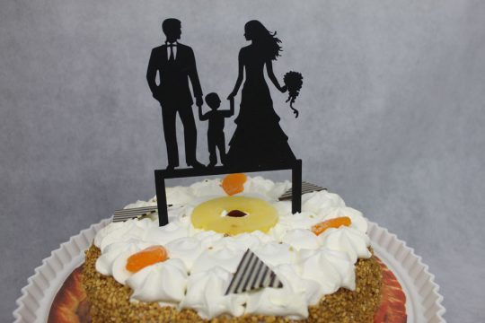 taarttopper man-vrouw en jongen